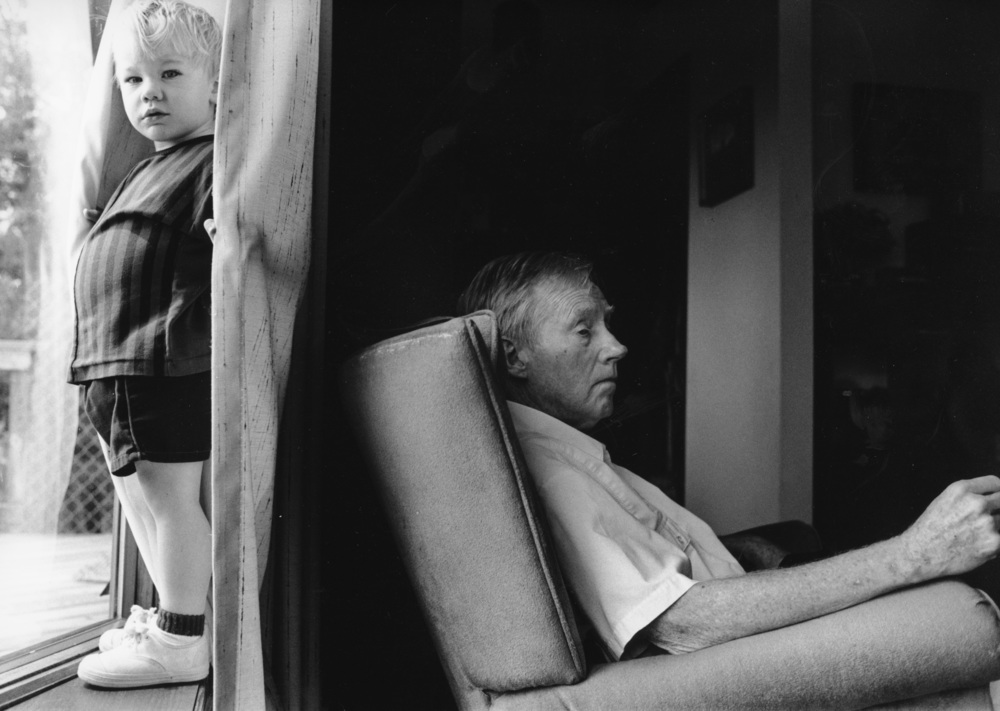 "Partial View: An Alzheimer's Journal:  Cary Smith Henderson and his grandson Eli.  ""I'd like a larger world than I have right now... I would love to see some people with Alzheimer's not trying to stay in the shadows all the time but say, ""Damn it, we're people too.""  © Nancy Andrews"