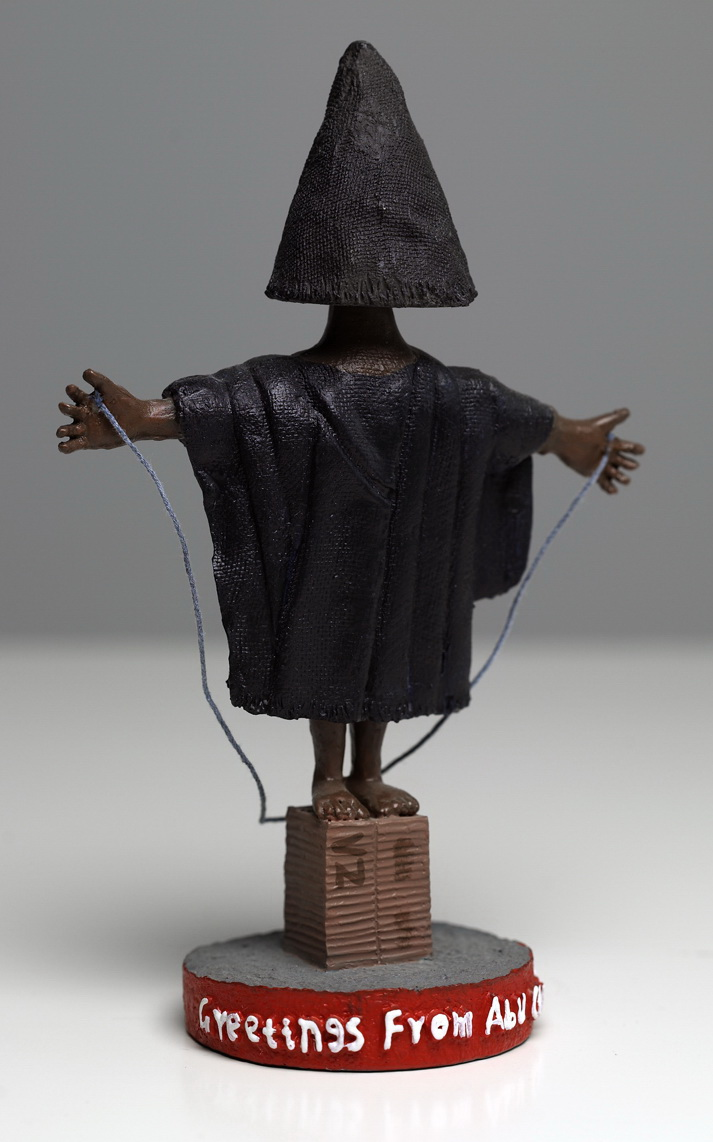 "From America the Gift Shop: Abu Ghraib bobble-head figurine.  Molded resin, 7"", 2008 © Phillip Toledano"