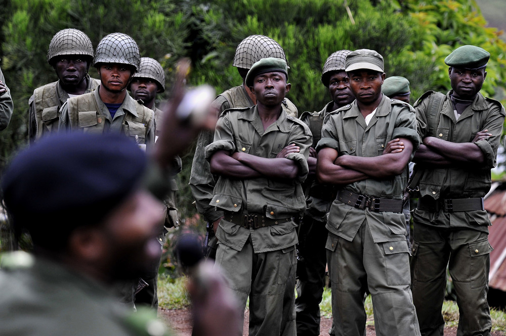 Congo's War on Women: Rape as a Tool of War:   Congolese National Army soldiers listen to sensitivity training.  © Mary F. Calvert /The Washington Times  / ZUMAPRESS.com