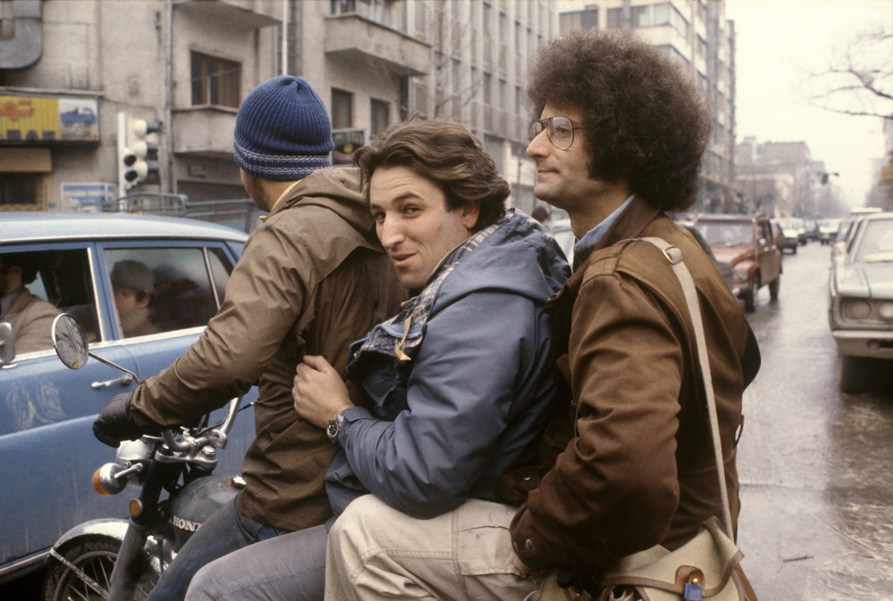 Olivier Rebbot (center) and David Burnett on motor bike: Tehran February, 1979. © 2015 David Burnett/Contact Press Images