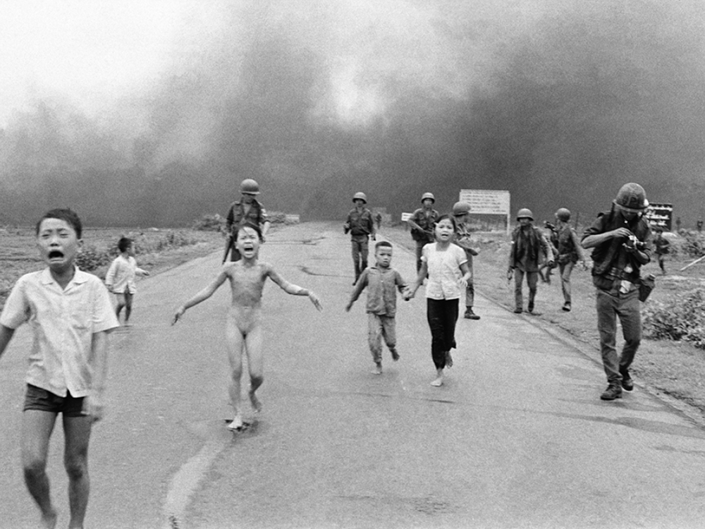 Trang Bang, Vietnam, June 8, 1972: 9-year-old Kim Phuc runs naked in  the street after a napalm attack. One of David Burnett's images from that fateful day is included in the gallery. © Nick Ut/AP