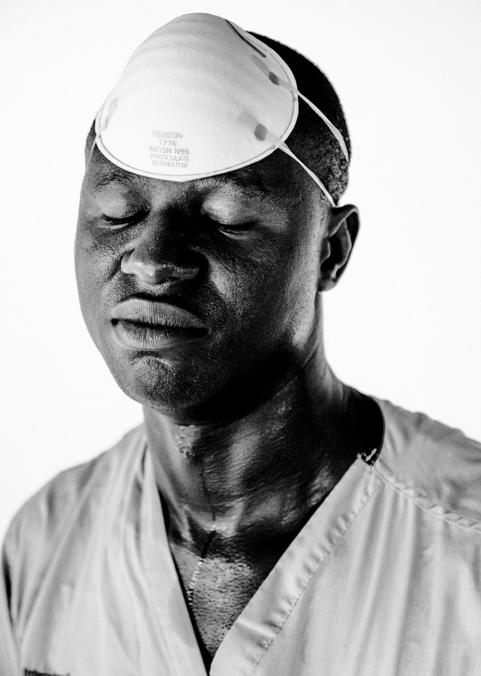 J. Sam T. G. Siakor, 30, water, sanitation and hygiene supervisor. October 2014 © Daniel Berehulak for The New York Times