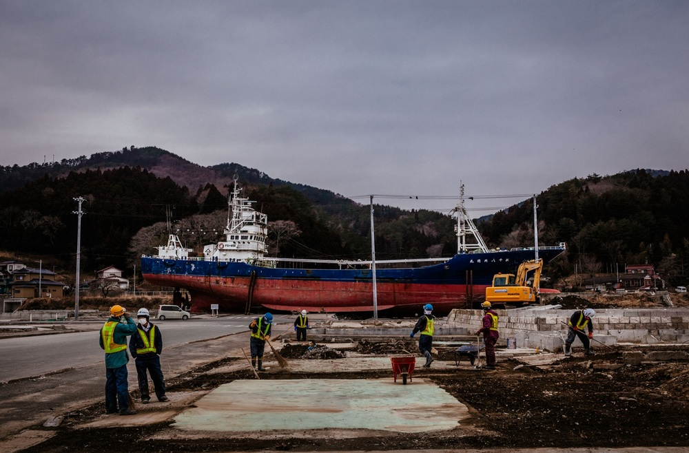 A fishing boat, dragged in-land during last year's tsunami, sits on the ground in Kesennuma, Japan. March 06, 2012 © Daniel Berehulak/Getty Images