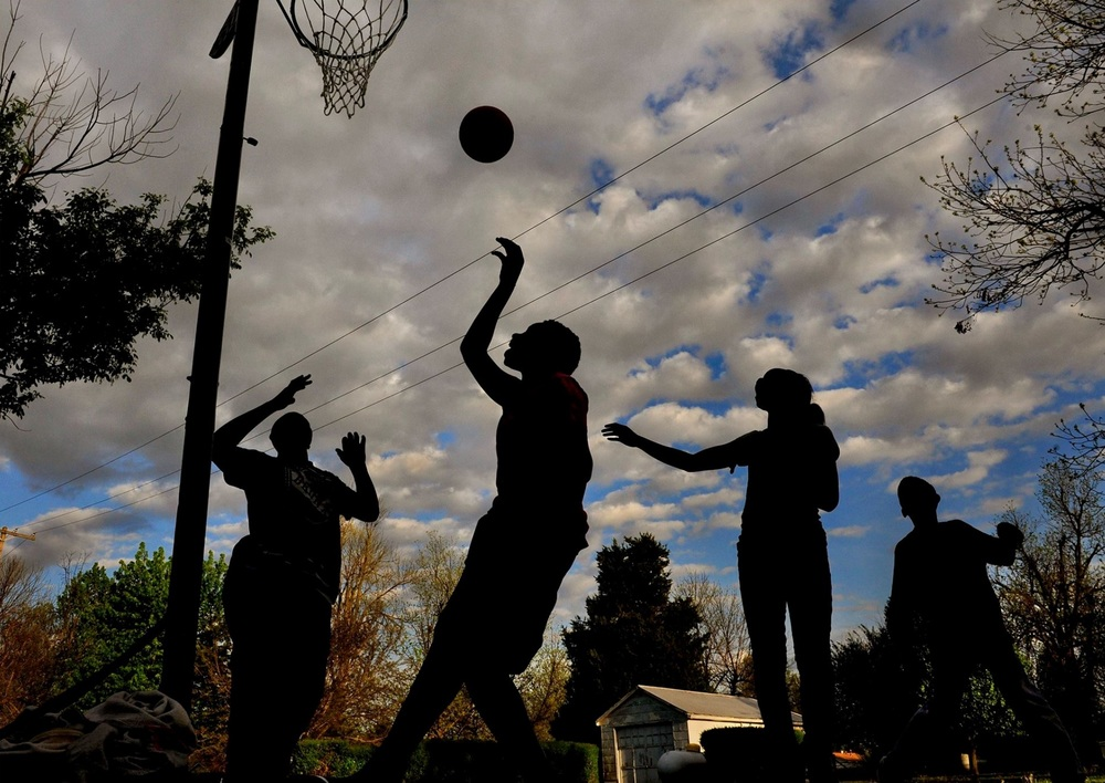 "While the new mayor and old mayor and the locals and the media went back and forth over what part of the recent resignations of police and city officials (after an African American woman was elected mayor) was related to race...on a poorly paved street in mixed race neighborhood just 4 blocks from city hall a group of teens played hoops. I didn't want to ruin their playtime by asking political questions but I did ask what THEY thought was the biggest issue in town. Andrew, (the kid shooing in the photo) didn't hesitate: ""Man, all we want is a place to play ball and not worry about getting hit by cars.""  — in Parma, Missouri. ©   2015   Michael S. Williamson/The Washington Post"