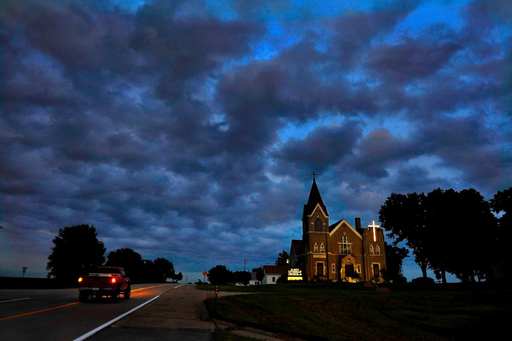 "Published stories the past 7 days answered the question some asked, (""What are you working on?"") Well, last Sunday the Katrina refugees in Nebraska, and the day after that the President Carter at church story and this morning the nice spread on car culture was in the paper: I connected the three (Nebraska-church-road pic) with this church photo from the Nebraska story. Seemed like Sunday would be a good day to post this. — in Falls City, Nebraska. ©   2015   Michael S. Williamson/The Washington Post"