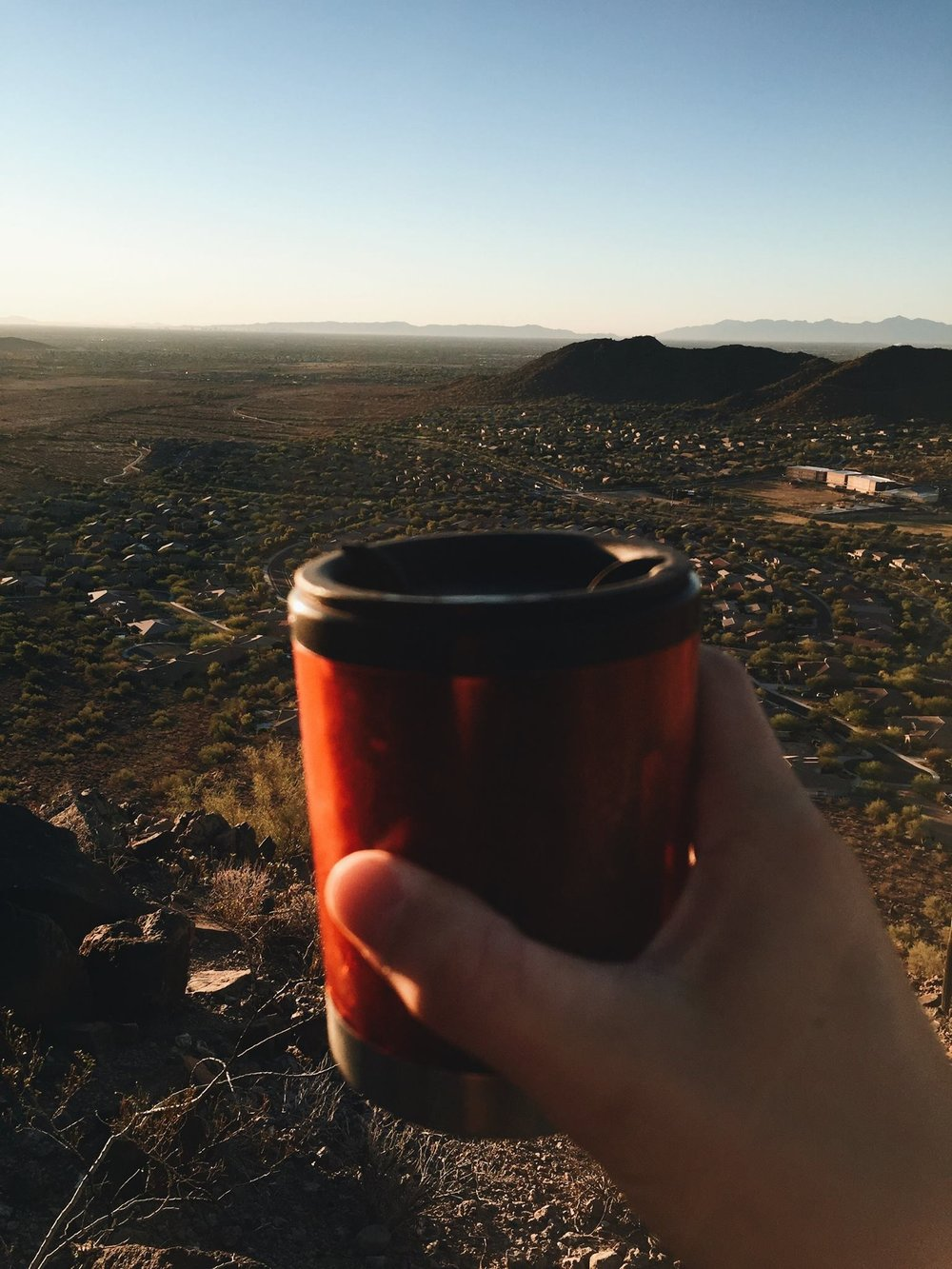 coffee mug on top of mountain