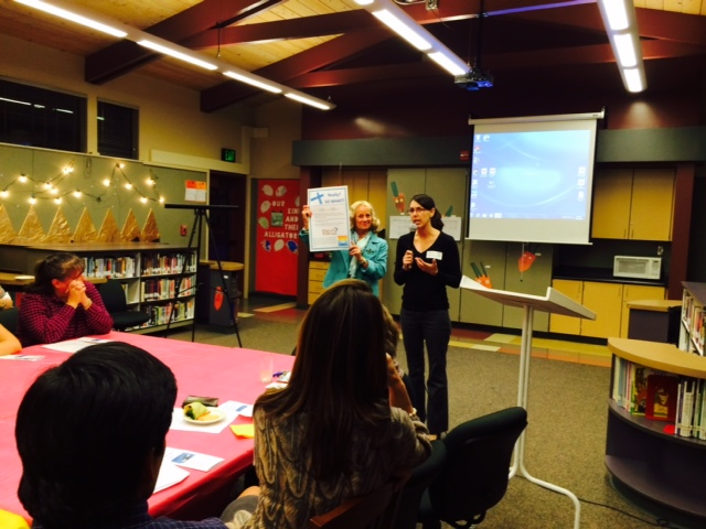Dr. Cheryl Lynn de Werff (left), principal of Howell Mountain Elementary School, and one of her teachers shares a class project with the group.