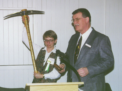 Past Presidents Carol Hasenberg and Ray Crowe make light with the GSOC pickaxe and gavel during the 2000 GSOC banquet.