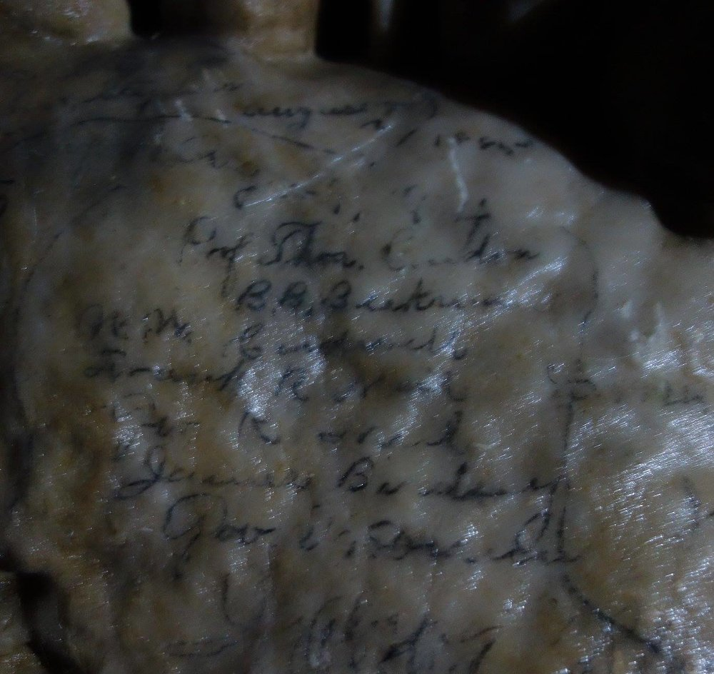 "Inside the cave, we photographed these signatures, beginning ""Prof Thom. Condon,"" and listing his students. The signatures are about 125 years old, encased in a thin layer of calcite."