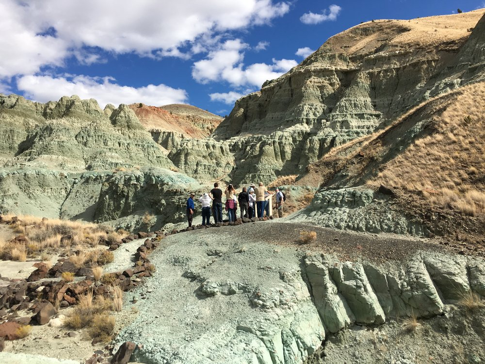 The group is dwarfed by the spectacular Turtle Cove Formation on Sunday's Blue Basin hike. Photo by author.