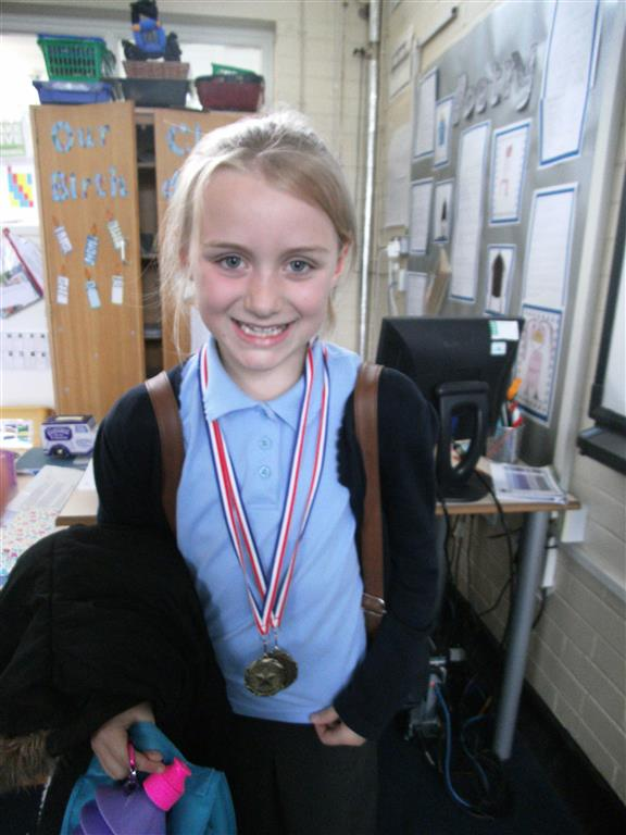 Honey brought in her dance medals to show us.  She has worked very hard to gain a medal for her country dancing.  Well done Honey! -