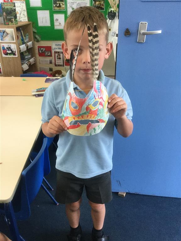 Alfie has made a tribe mask at home out of cardboard, pencils and feathers.  It looked very scary! -