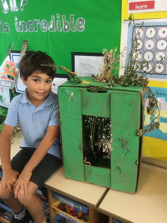 Kiran brought in his rainforest model this week to show the class.  Can you spot all of the different animals in it? -