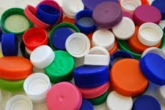 We want your plastic bottle tops!Please start saving now and bring them in to school in September.  -