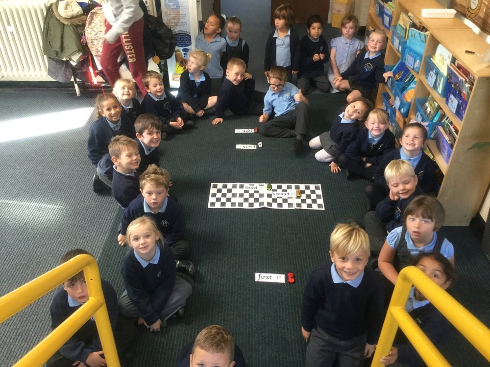 We have also been learning about ordinal numbers. We had a car race and labelled our cars to show what position they came in. -