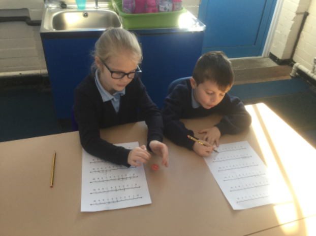 In maths, we have continued learning about addition and subtraction. Y2s have been using base 10 to add 2 two digit numbers together crossing 10s. They have been learning how to exchange 10 ones for 1 ten. Y1s have been learning how to subtract, and have used a number line to help them find the answer. -