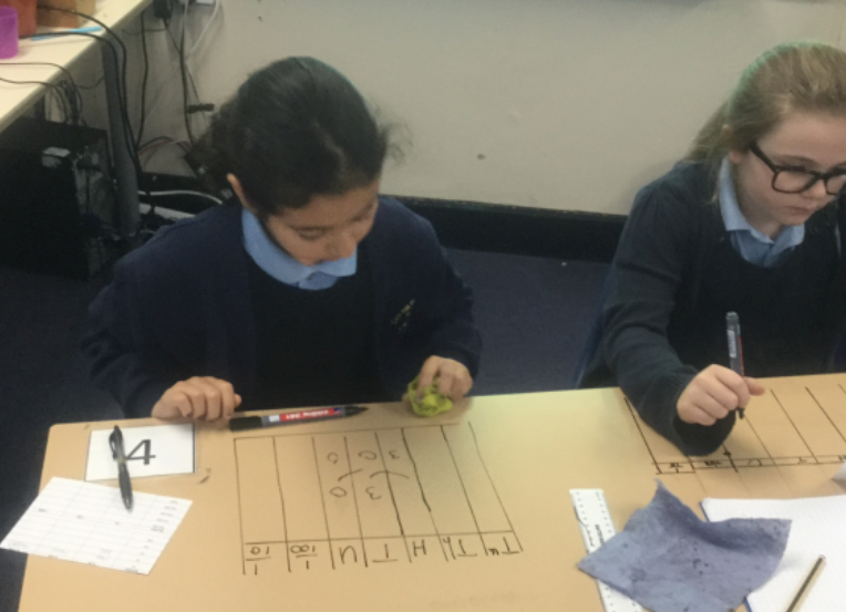 Maths: This week in maths we have been multiplying and dividing by 10,100 and 1000. To help we used place value grids to visualise the calculations, we had lots of fun completing our calculations on the tables. -