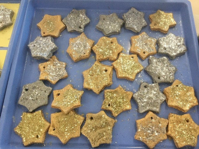 We decorated the salt-dough stars we have made for the enterprise challenge. We will be selling these for 50p. All we need to do now is to think of a good way to hang them from a tree! -