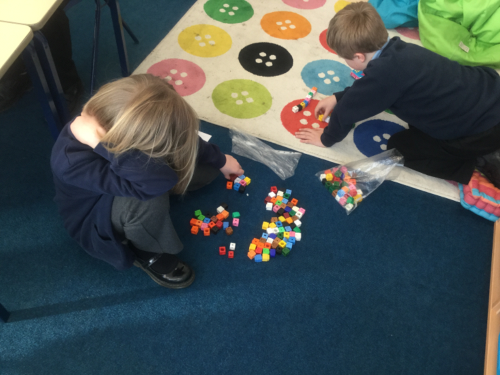 Ethan and Phoebe spread out onto the floor to make sure they had lots of room to convert their fractions!  -