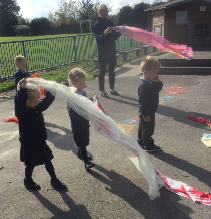 Later on in the week it was so windy that we experimented with different materials to see what happened in the wind. We had lots of fun and had to catch the silk scarves before they blew up into the trees! -