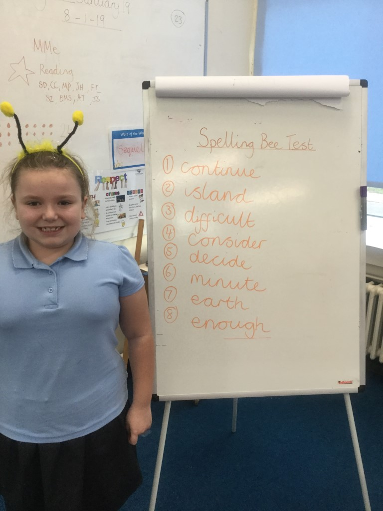 Our new 'Spelling Bee Champion' is Ellie-Mae. Well done! -