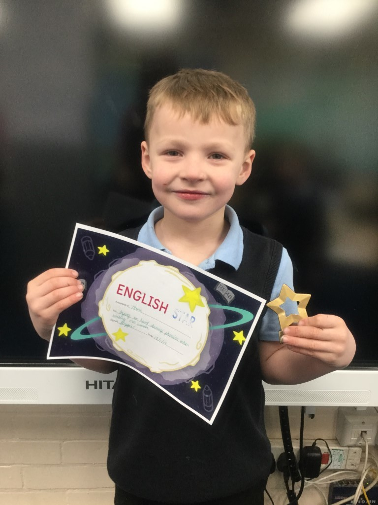 Travis received the English star for trying so hard during phonics when writing CVC words. -