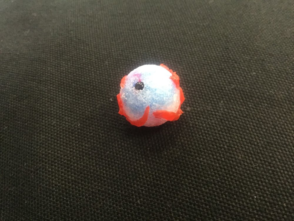 In other news, Liam brought in the mini science project that he had completed at home. He had used some artists san and a bead to create a miniature model of an eyeball. -