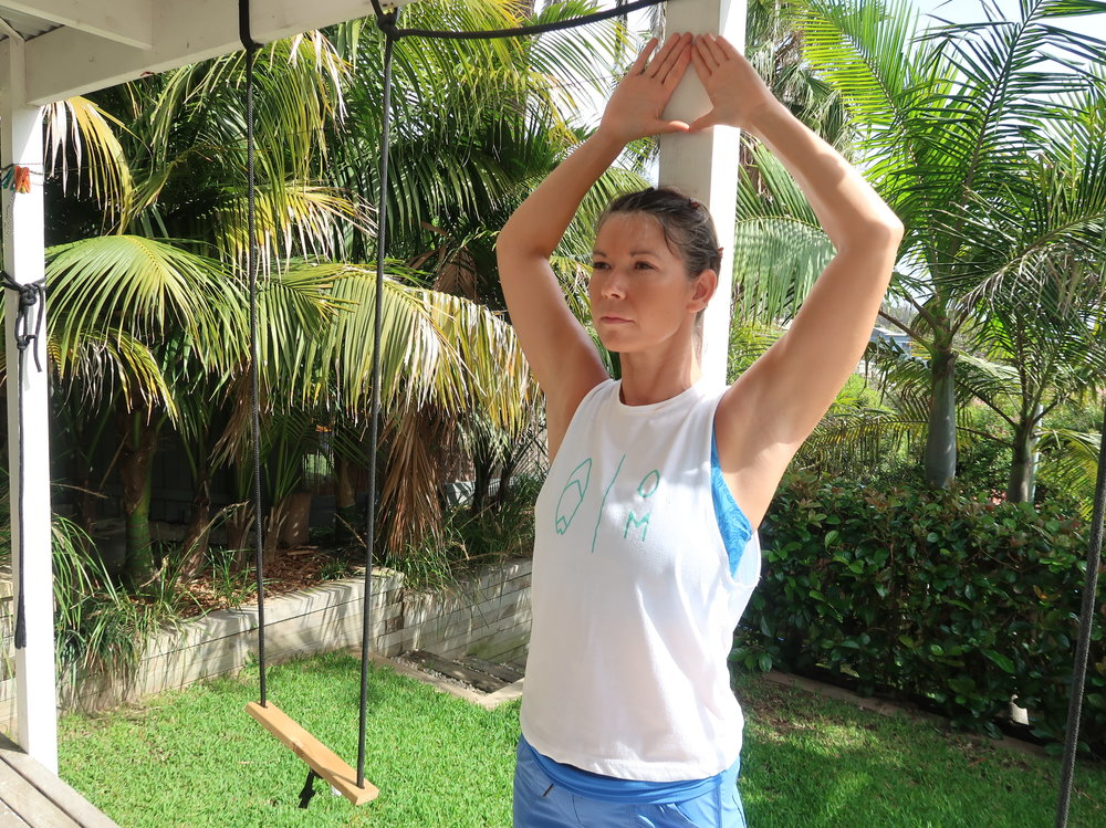 Standing wall wings  – stand with your back to the wall with thumbs touching. Keep hands & back touching the wall as you open your elbows towards wall keeping the shoulders relaxed down the spine.