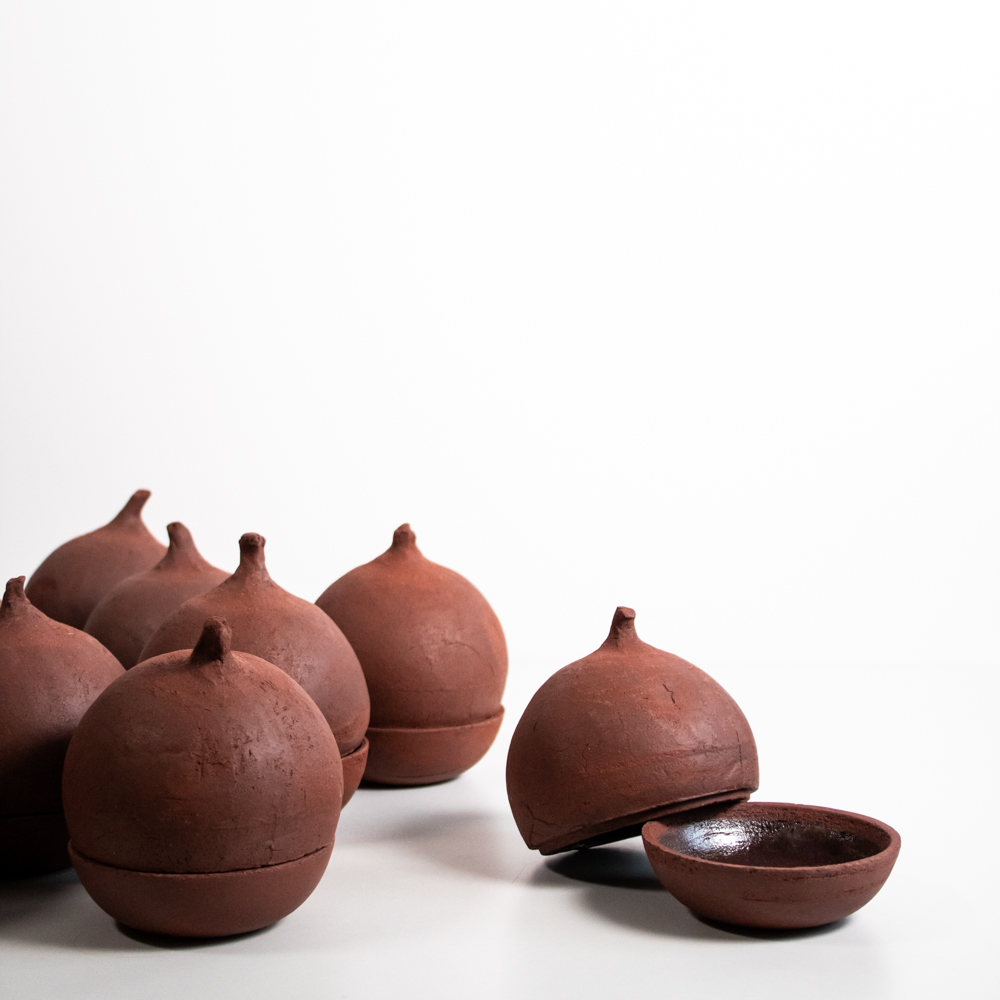 Ceramic beetroots made from red stoneware clay with a violet glaze on the inside. It is always a challenge to make ceramic objects with high precision; this is why we fire the top and bottom together to avoid deformation.