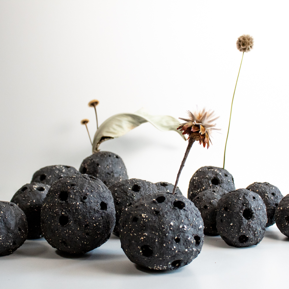 Flower containers made from very rough clay. The ball-like objects have some small and some larger holes to offer flexibility when it comes to flowers. Collaboration with  Stilken & Strøm .