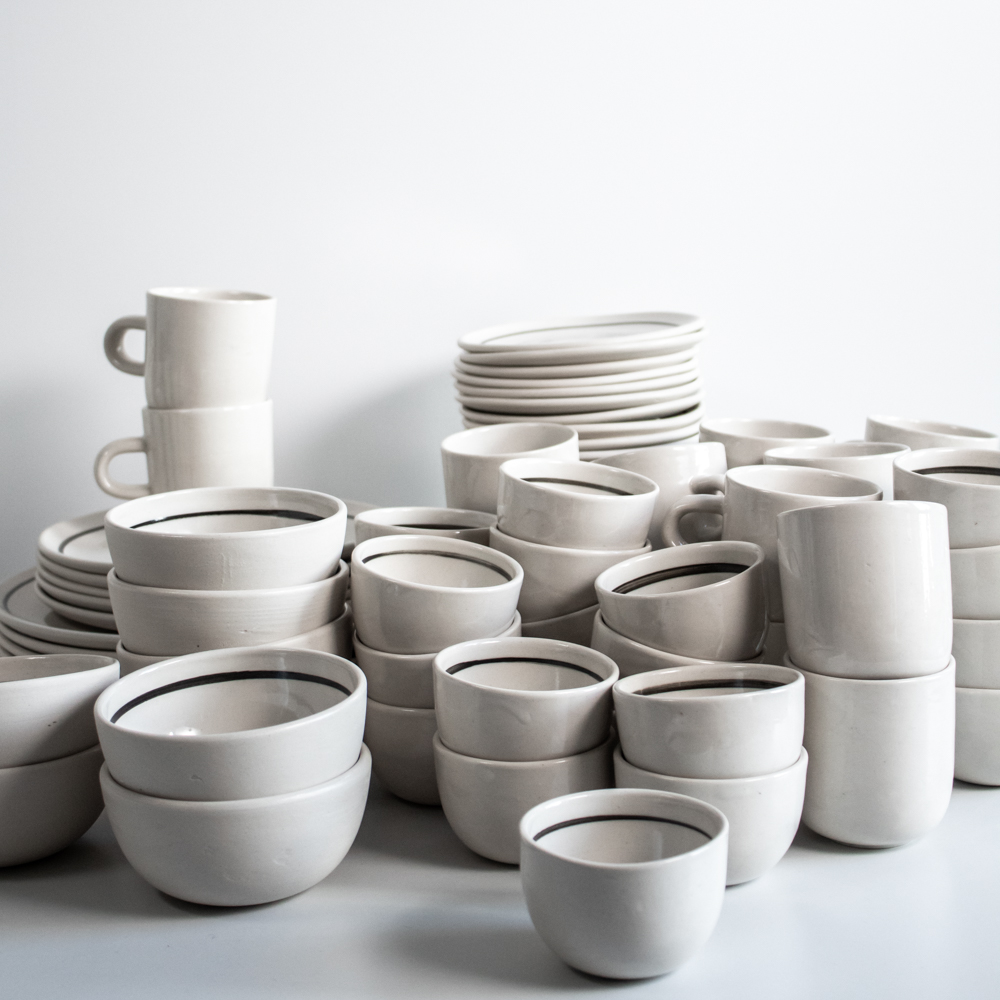 The tableware for Eilert Smith consists of our Soft Curve plates in three sizes, our smallest Bowler, a low-cut version of the big Bowler, Kuppi with a handle and tea cups (not pictured).