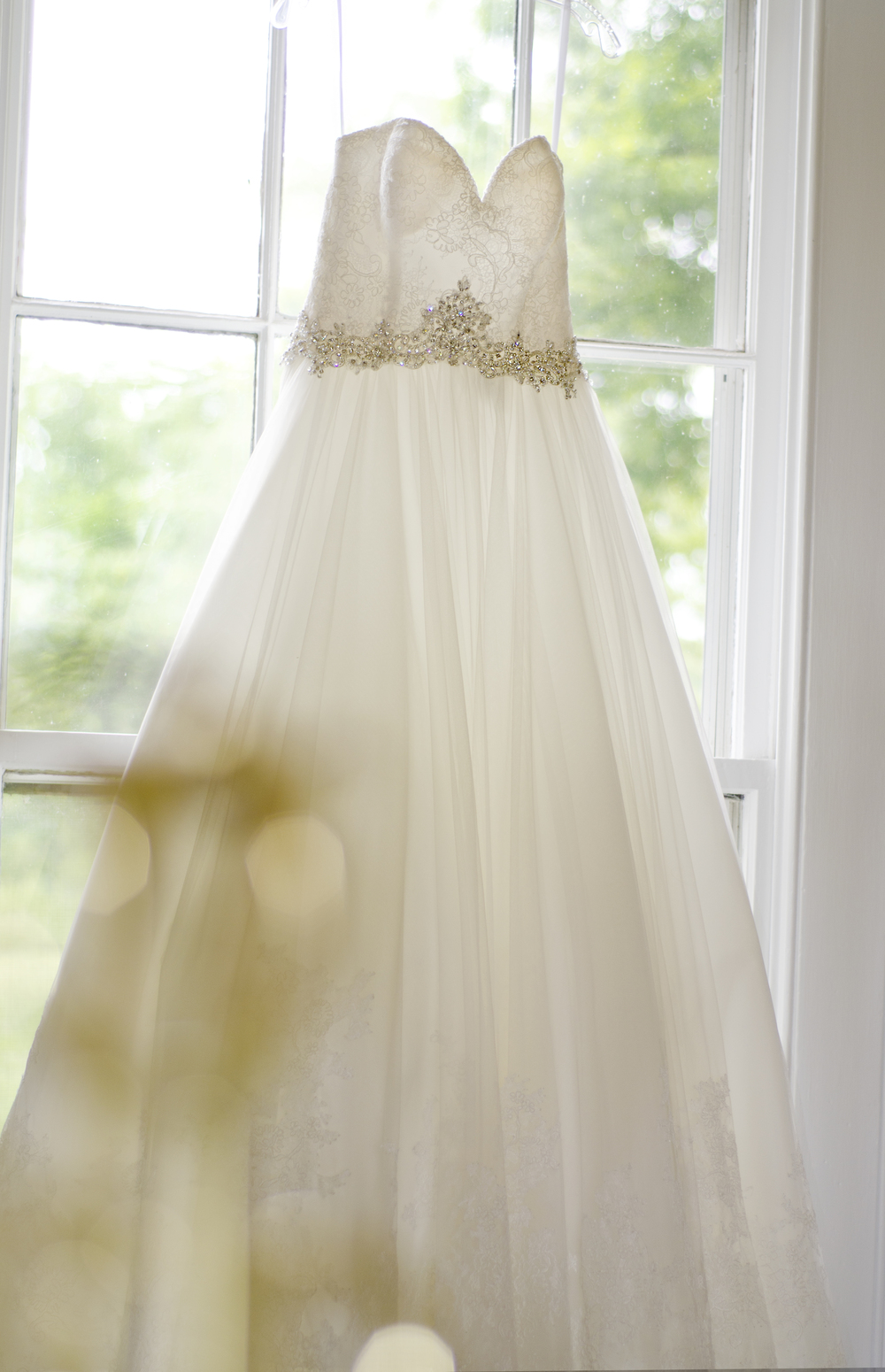 wedding gown in window - farm wedding - copyright