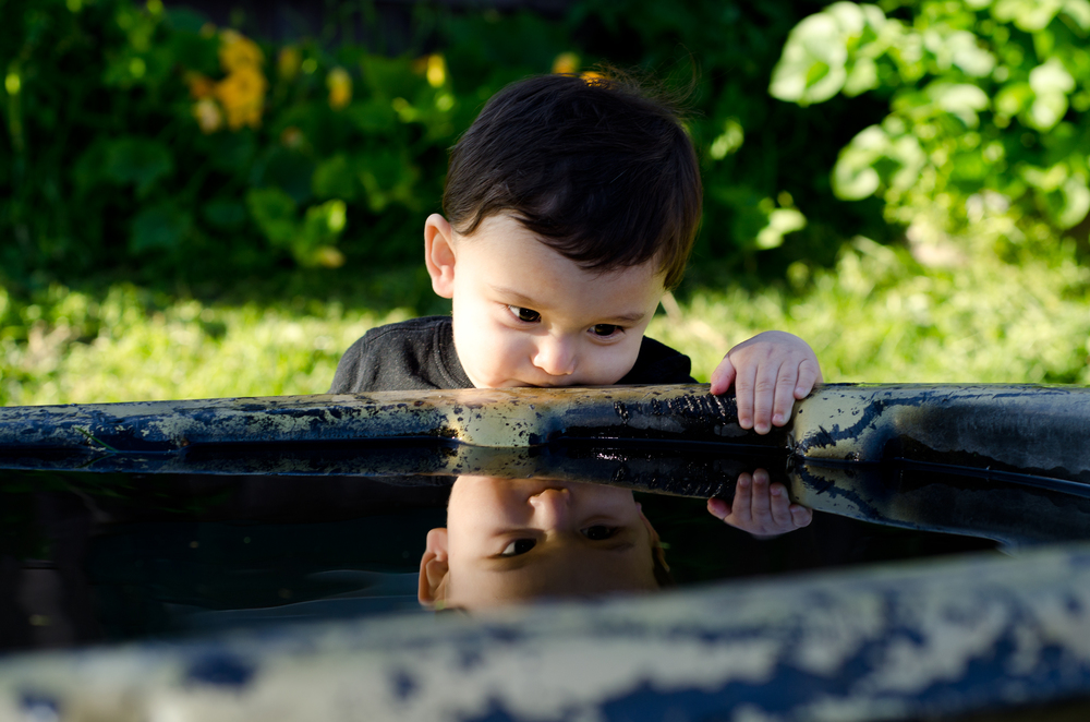 baby leaning over water - fairbanks ak photographer