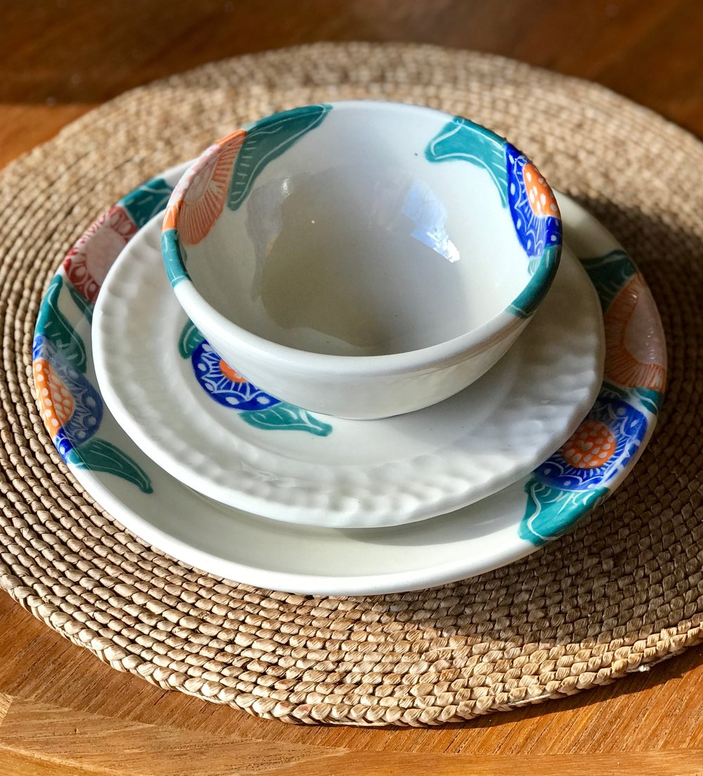 Hello! - I am a working ceramic artist in Des Moines, Iowa. I make elegant, brightly patterned functional porcelain pottery. All of my work is handmade on the potters wheel and hand decorated using my own designs in a method called sgraffito. Sgrafitto is an Italian method of decorating where a colored slip or underglaze is a applied and then carved through to reveal the clay beneath.I work out of my studio at Mainframe Studios. 900 Keosauqua Way. My studio is #419. Please stop by and say hi at one of our monthly First Friday events. Artists have their studios open, it is a great way visit, and learn more about the artists and art being made at Mainframe. For more info on Mainframe please check out the website. http://mainframestudios.orgYou can find me hereshop.etsy.com/shop/MacFarlandPotteryemilymacfarlandceramics@gmail.com
