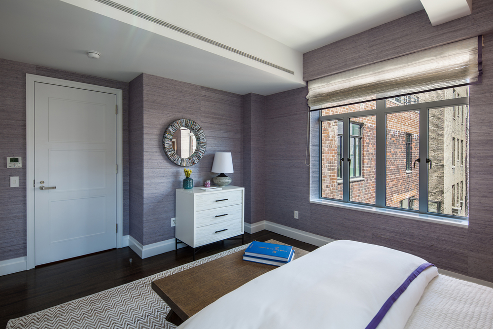 A bedroom in a Park Ave Apartment fitted out with HVAC equipment from start to finish , by Powerair.