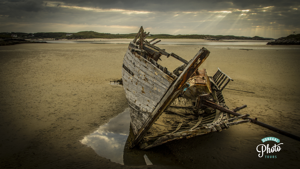 Another view of the shipwreck with the rays shining onto Magherclogher Strand