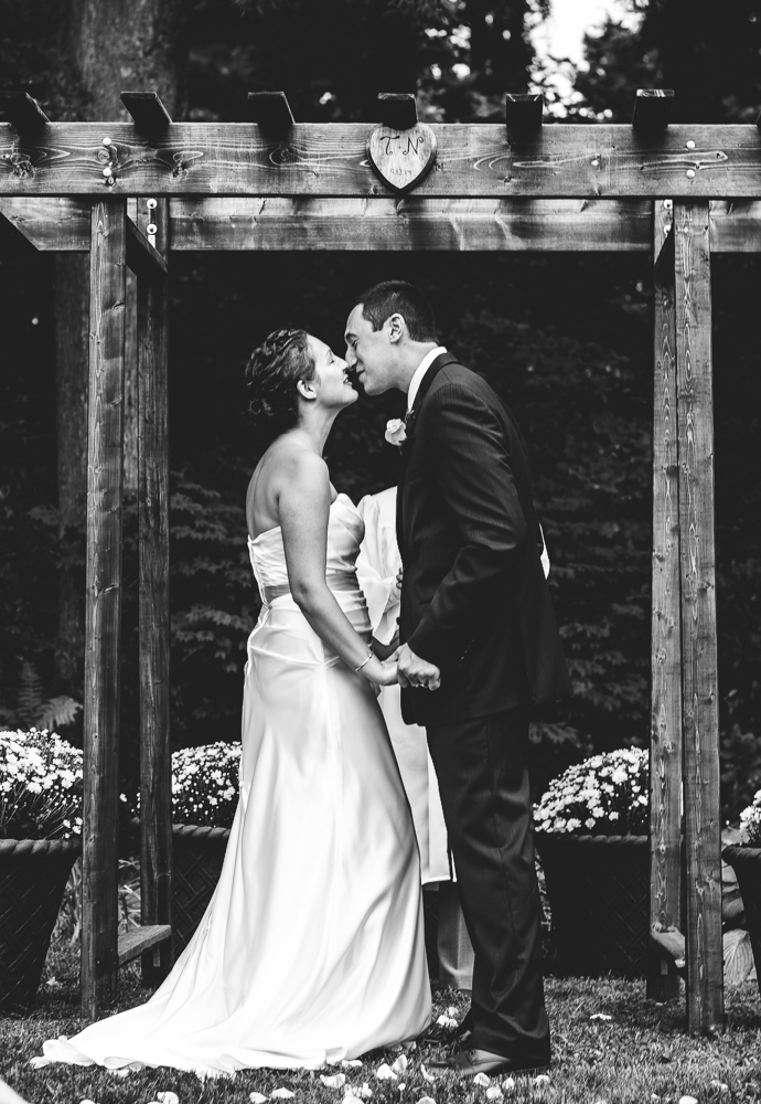 you may kiss the bride.... under a beautiful archway that the groom built.
