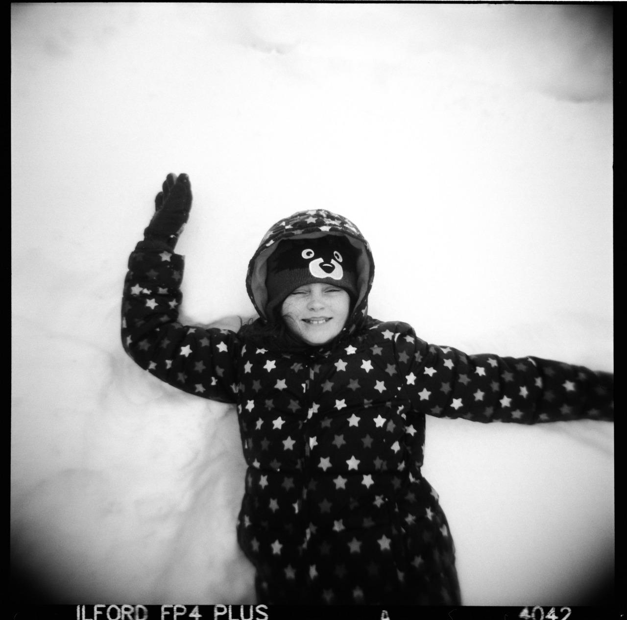 Em In Snow,  Holga, Ilford FP4.    Nicholas Schietromo