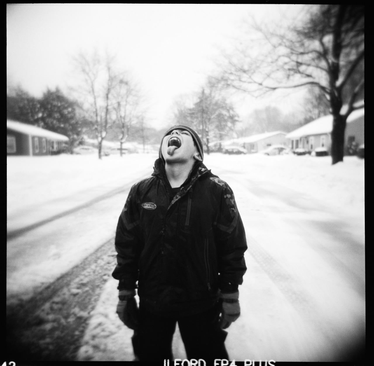 Owen Catching Snowflakes,  Holga, Ilford FP4.      Nicholas Schietromo