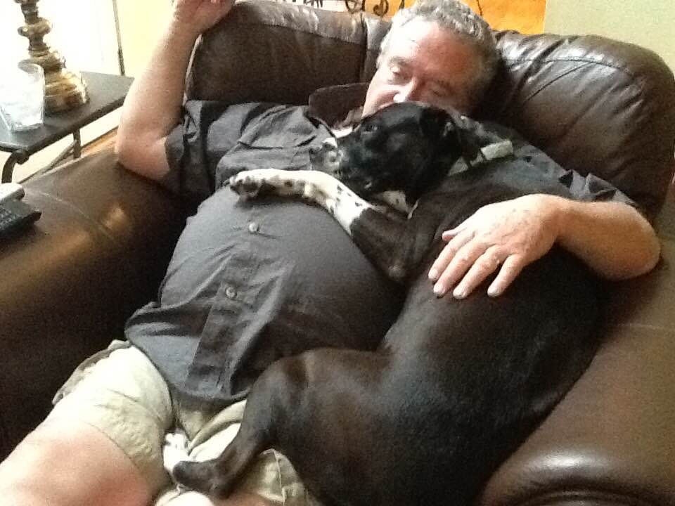 Weezy sleeping in my Daddy's lap. They loved each other so much!