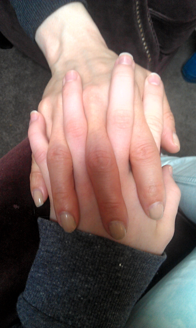 Martha's hand entwined in mine