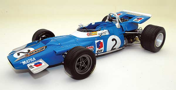 Image From :http://www.f1fanatic.co.uk/2009/01/08/50-years-of-british-champions-in-pictures-autosport-international-2009/jackiestewart_matrams80-1/