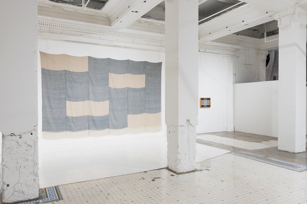 "Untitled , 2017, linen, natural dyes, 192"" × 136""  Untitled is DuVall's largest work to date and her first full-scale draped piece. It was made specifically for this space. By experimenting with different methods of display, such as framing, hanging, and draping, the artist is able to highlight different features of the textiles. Draping adds dimension and changes how color reads, while framing highlights seams and imperfections."
