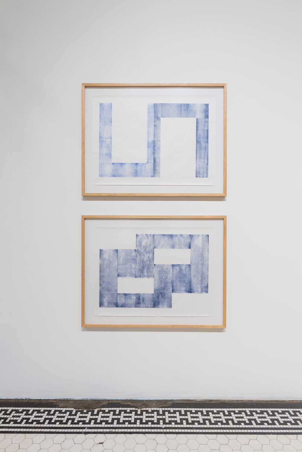 Rachel DuVall's preparatory process can last for more than a month and involves measurements, calculations, and the creation of a blueprint drawing for each work. Her recent work includes woodblock prints that are situated between the concise planning of her drawings and the looseness of her finished weavings.