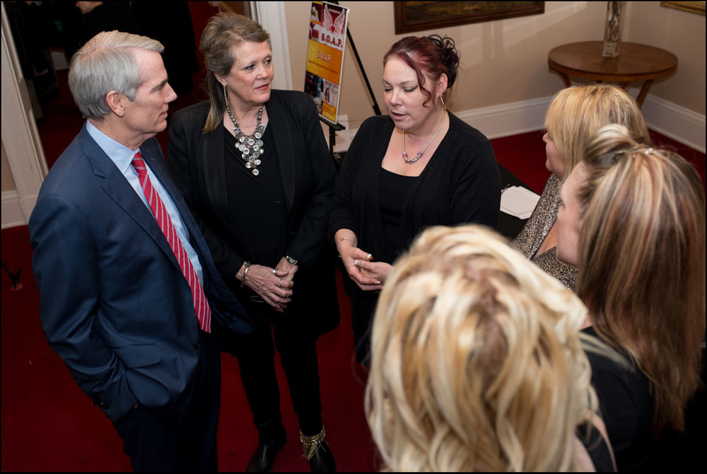 Senator Portman speaking with sex trafficking survivors and advocates.