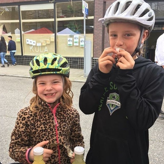 Happy visitors at the Ballard Farmers Market! Using their allowance money to purchase our brine.