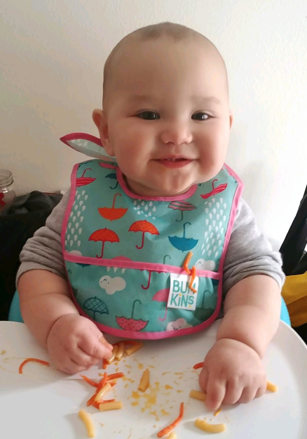 Auden loves her Yin Yang Carrots — with just 2 teeth!