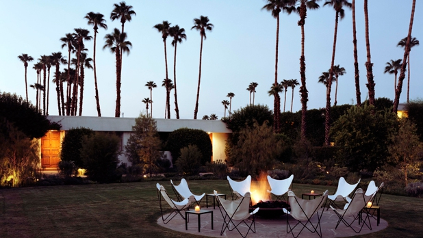 Crisp white chairs surround a fire pit to keep guests warm while enjoying the peace and isolation among only the stars as witnesses.