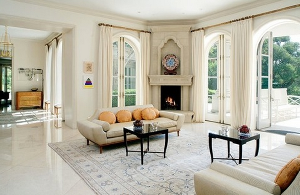 Formal living room, complete with fireplace and oversized white tiled floors.