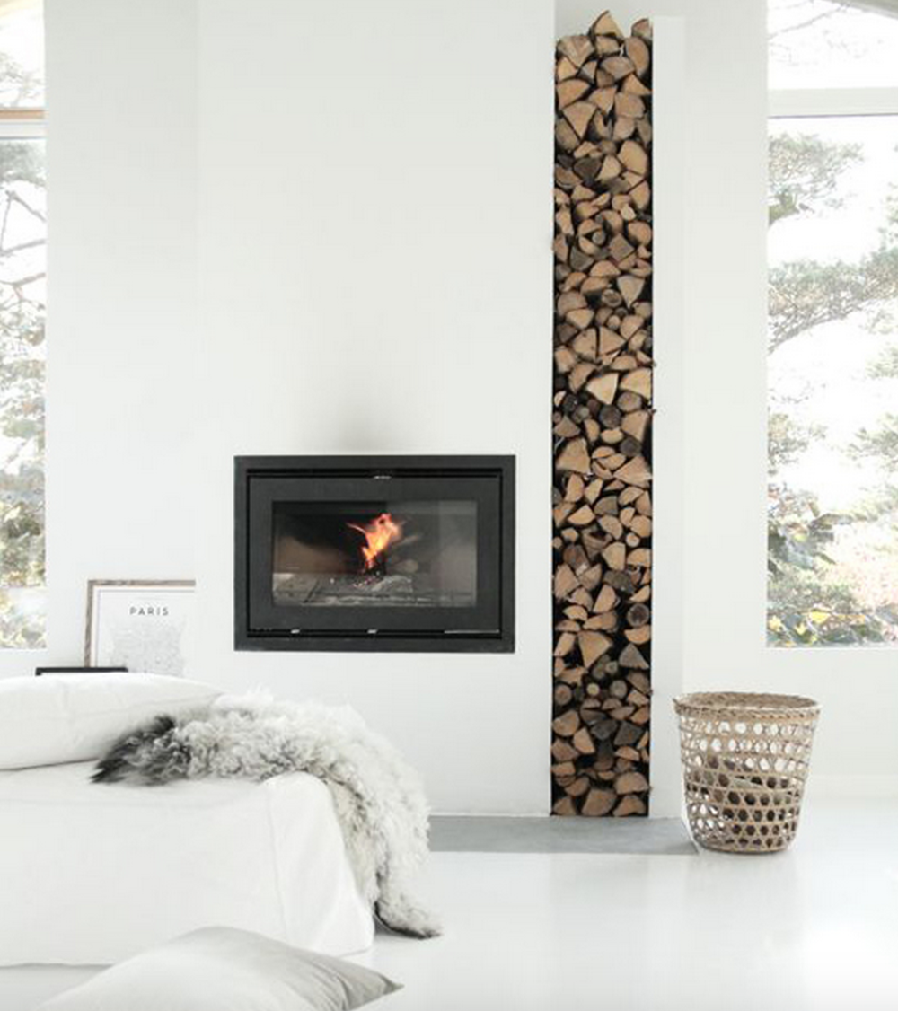 This fireplace is simple, yet adds texture with an opening for stacking wood.